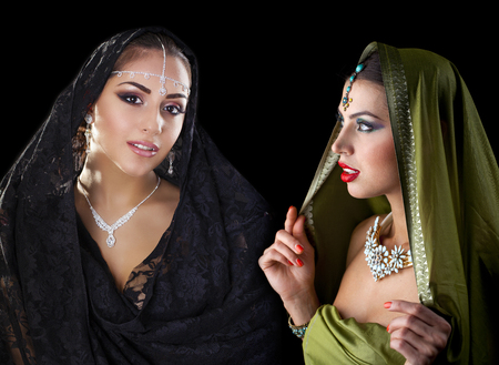 sari: Collage two women in sari. Close up portrait of beautiful eastern models on a black background Stock Photo