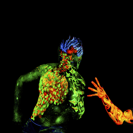 ultraviolet: Fire and Land, Body art glowing in ultraviolet light, isolated on black background