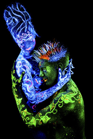adult mermaid: Land Loves Air. Body art glowing in ultraviolet light, four elements, isolated on black background Stock Photo