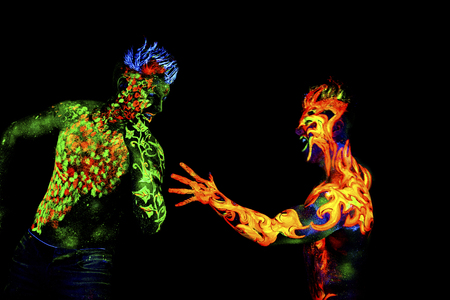an ultraviolet: Fire and Land, Body art glowing in ultraviolet light, isolated on black background