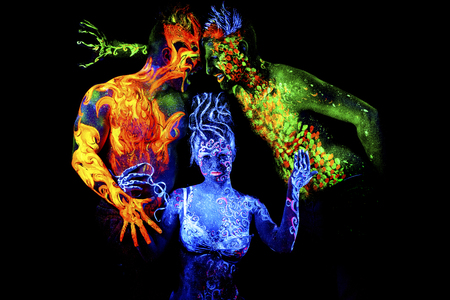 an ultraviolet: Fire, Land and Air. Body art glowing in ultraviolet light, four elements, isolated on black background