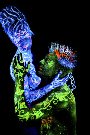 four elements: Land Loves Air. Body art glowing in ultraviolet light, four elements, isolated on black background Foto de archivo