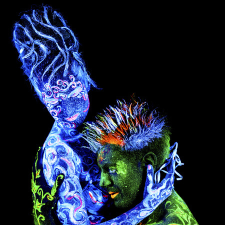 four elements: Land Loves Air. Body art glowing in ultraviolet light, four elements, isolated on black background Stock Photo