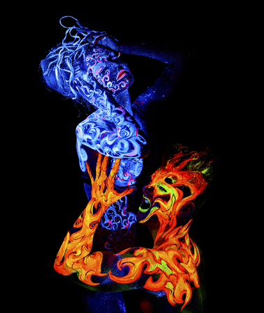four elements: Fire and Air. Body art glowing in ultraviolet light, four elements, isolated on black background
