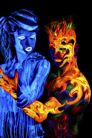 aqua naked: Water against Fire. Body art glowing in ultraviolet light, four elements, isolated on black background Stock Photo