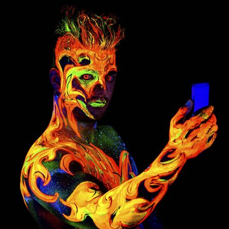 ultraviolet: Fire, Body art glowing in ultraviolet light, isolated on black background