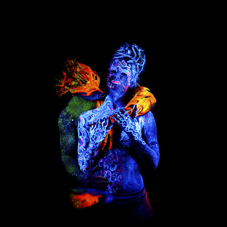 an ultraviolet: Fire and Air. Body art glowing in ultraviolet light, four elements, isolated on black background