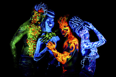 ultraviolet: Four elements. Body art glowing in ultraviolet light, isolated on black background