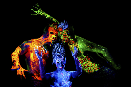 four elements: Fire, Land and Air. Body art glowing in ultraviolet light, four elements, isolated on black background