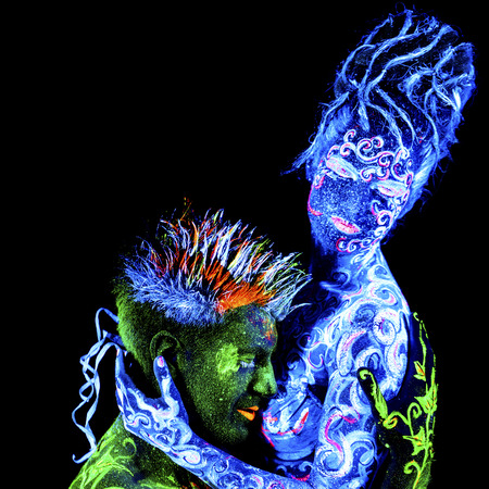 ultraviolet: Land Loves Air. Body art glowing in ultraviolet light, four elements, isolated on black background Stock Photo