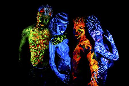 four elements: Cuatro elementos. brillante arte del cuerpo a la luz ultravioleta, aislado sobre fondo negro Foto de archivo