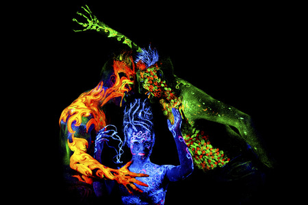 adult mermaid: Fire, Land and Air. Body art glowing in ultraviolet light, four elements, isolated on black background