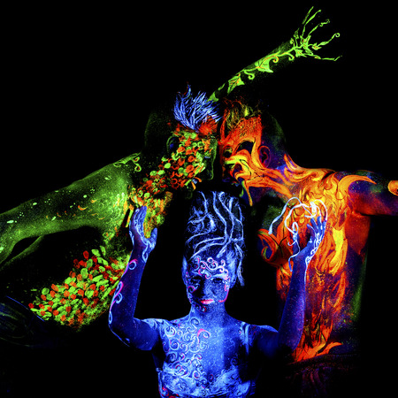 ultraviolet: Fire, Land and Air. Body art glowing in ultraviolet light, four elements, isolated on black background