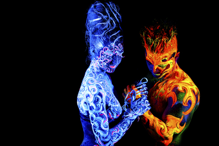 adult mermaid: Fire and Air. Body art glowing in ultraviolet light, four elements, isolated on black background