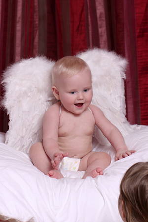 angel alone: Closeup six month old baby blonde boy