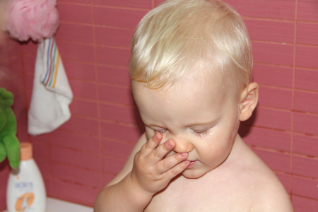 slumberous: Portrait of blonde baby boy in bathroom