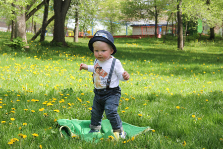 10 month: Cute ten month baby boy in spring park