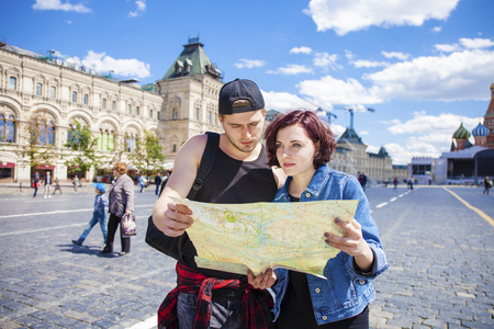 red square: Happy tourists sightseeing city with map. Red Square, Moscow, Russia