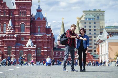 red square moscow: Happy tourists sightseeing city. Red Square, Moscow, Russia