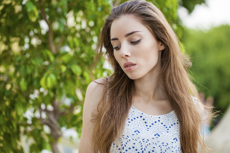 clean street: Close up portrait of beautiful young happy brunette woman with fresh and clean skin, summer street outdoors Stock Photo