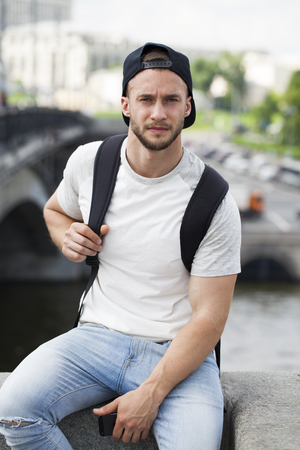 black cap: A young and attractive man in black cap