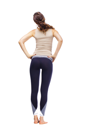Back view of a sporty woman posing on white background Stock Photo