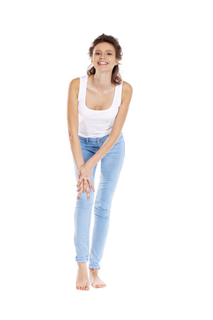 Happy brunette girl in white t-shirt and blue jeans, isolated on white background Stock Photo