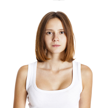 Portrait of a brunette woman without makeup, isolated on white background Reklamní fotografie