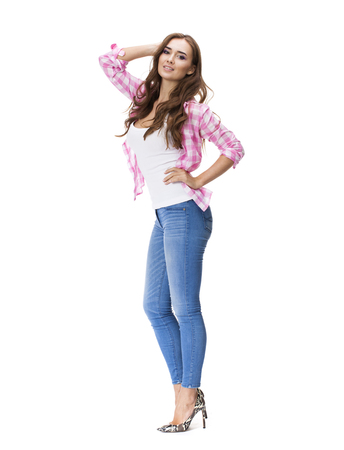beauty full: Young beautiful brunette woman in blue jeans and pink shirt, isolated on white background