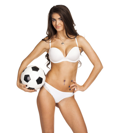 Sexy womens soccer. Young sexy brunette woman in white underwear, isolated on white background