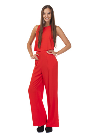 pantsuit: Young beautiful brunette woman in red pantsuit, isolated on white background Stock Photo