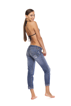whitebackground: Young beautiful brunette woman in blue jeans, isolated on whitebackground