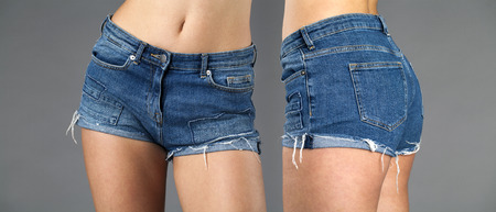 Female denim blue shorts front and rear. Body part sexy jeans shorts, isolated on gray background