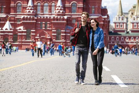 red square moscow: Happy tourists sightseeing city with map. Red Square, Moscow, Russia