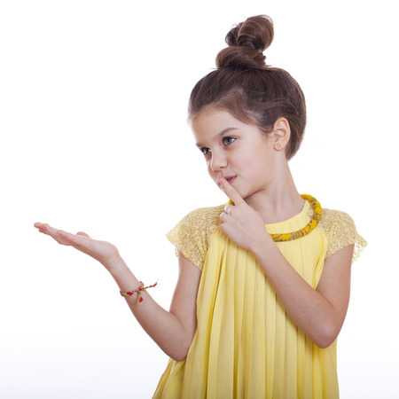 Beautiful youth little girl presenting copy space, studio on white background