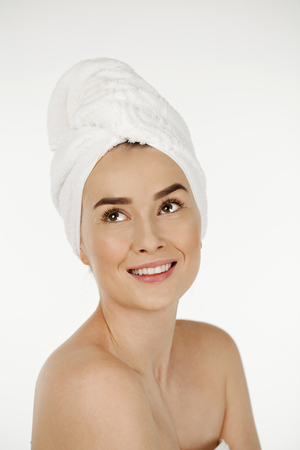 Portrait of a bared beautiful woman getting ready for the spa treatment, isolated on a white background, please see some of my other parts of a body images Stock Photo