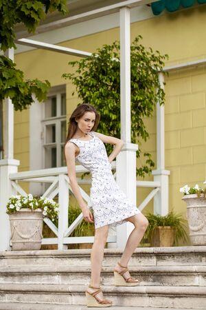 summer dress: Young beautiful brunette woman in summer dress