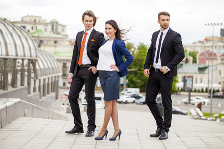 Three Business people outside office Stock Photo