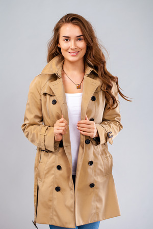 Portrait of a young woman without make-up. Beautiful brunette model in beige coat Stock Photo