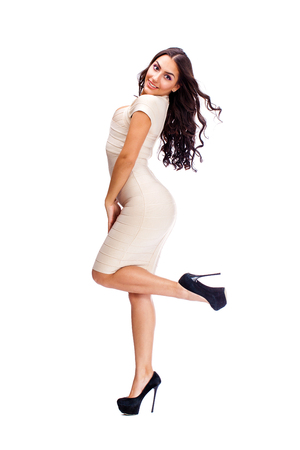 Young arabic woman in beige sexy dress, isolated on white background Stock Photo