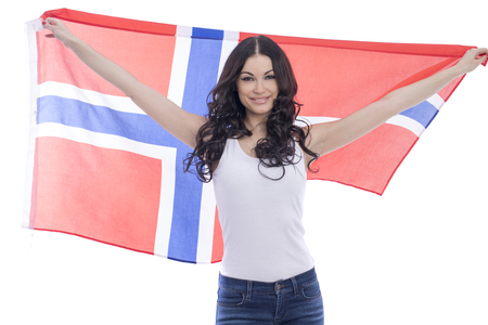 Young beautiful brunette woman holding a large transparent flag of Norway, isolated on white background