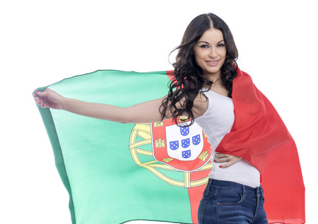 Young beautiful brunette woman holding a large flag of Portugal, isolated on white background