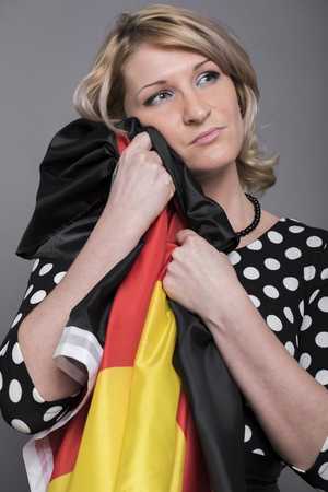 Grieving germanium, a young German woman covers her face hand Stock Photo