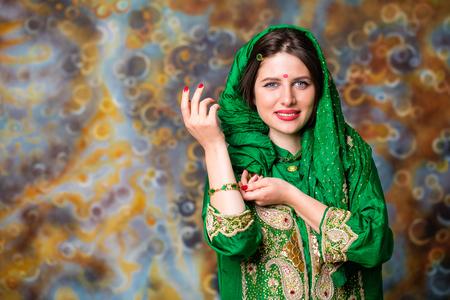 Armenian beauty. Close up portrait of beautiful eastern woman in green sari