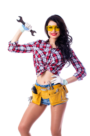 Project Satisfaction. Sexy brunette woman mechanic with a wrench, isolated over white background