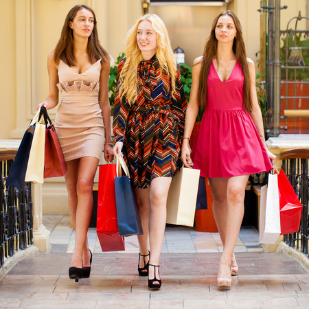 go shopping: Young beautiful women with some shopping bags walking in the mall Stock Photo