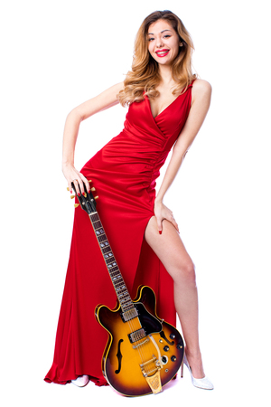 Podolsk, Russia - February 22, 2017: Young brunette Woman with a vintage electric guitar Gibson es-345 1969 model year