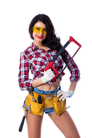 Project Satisfaction. Beautiful sexy housewife in goggles with a hacksaw in hand, isolated on white background