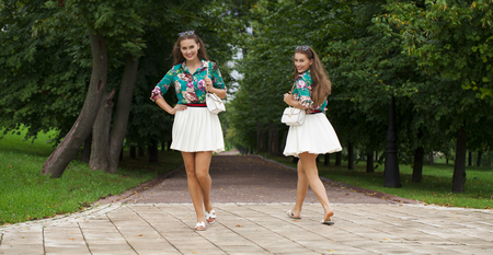 Collage, Young happy brunette women in white skirt and blouse walking in the summer park