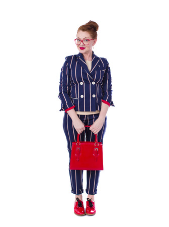 trouser: Stylish middle-aged lady in impressive checkered suit isolated on white background